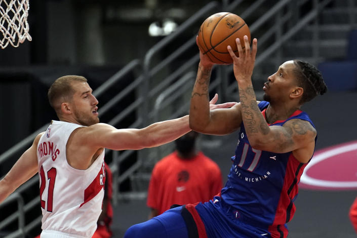 Detroit Pistons guard Rodney McGruder (17) shoots in front of Toronto Raptors guard Matt Thomas (21) during the second half of an NBA basketball game Wednesday, March 3, 2021, in Tampa, Fla. (AP Photo/Chris O'Meara)