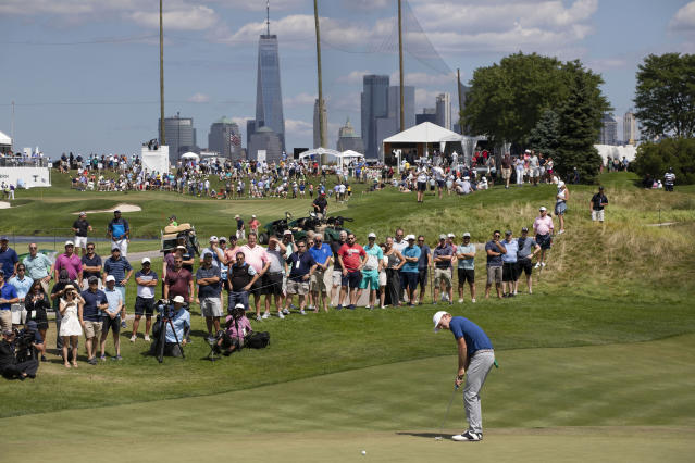 Brandt Snedeker putts on the third hole in the final round of the Northern Trust golf tournament at Liberty National Golf Course, Sunday, Aug. 11, 2019 in Jersey City, N.J. (AP Photo/Mark Lennihan)