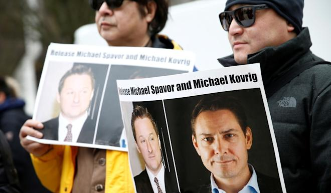 People hold signs calling for China to release Canadian detainees Michael Spavor and Michael Kovrig during an extradition hearing for Huawei chief financial officer Meng Wanzhou at the British Columbia Supreme Court in Vancouver in March. Photo: Reuters