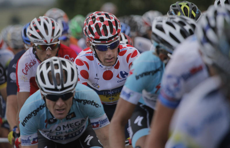 Michael Morkov of Denmark, wearing the best climber's dotted jersey, rides in the pack during the sixth stage of the Tour de France cycling race over 207.5 kilometers (129 miles) with start in Epernay and finish in Metz, France, Friday July 6, 2012. (AP Photo/Christophe Ena)