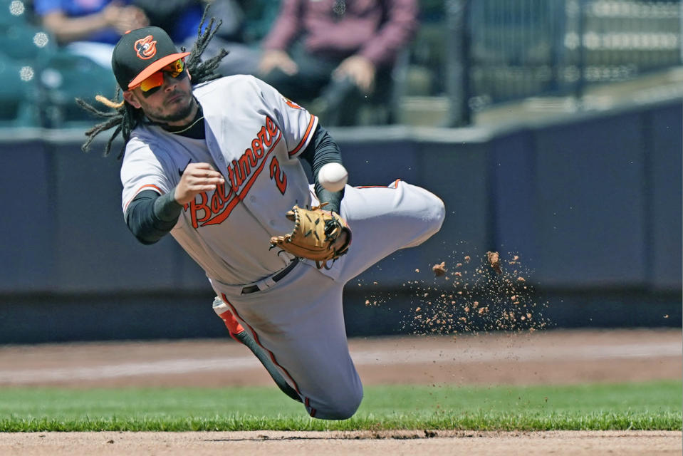 Baltimore Orioles shortstop Freddy Galvis (2) throws to second to hold the runner on base during the third inning of a baseball game against the New York Mets, Wednesday, May 12, 2021, in New York. (AP Photo/Kathy Willens)