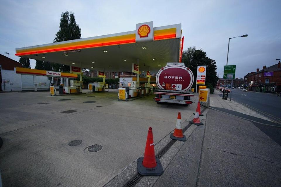A petrol tanker delivers fuel to a Shell petrol station in Liverpool which was closed due to having no fuel (Peter Byrne/PA) (PA Wire)