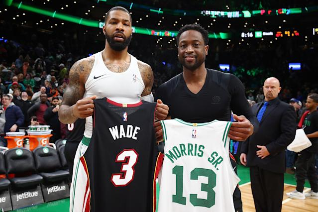 The Celtics' Marcus Morris (L) and Dwyane Wade swap jerseys after Monday's game in Boston. (Getty Images)