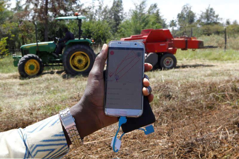 A mobile phone application shows movements of a John Deere 5503 tractor, installed with the Hello Tractor technology that connects farmers with vehicles' owners, in Umande village in Nanyuki
