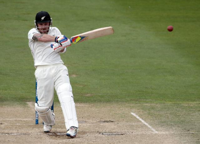 New Zealand's Brendon McCullum plays a shot against India during the second innings of play on day five of the second international test cricket match at the Basin Reserve in Wellington, February 18, 2014. REUTERS/Anthony Phelps (NEW ZEALAND - Tags: SPORT CRICKET)