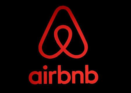 FILE PHOTO: The logo of Airbnb is displayed at an Airbnb event in Tokyo