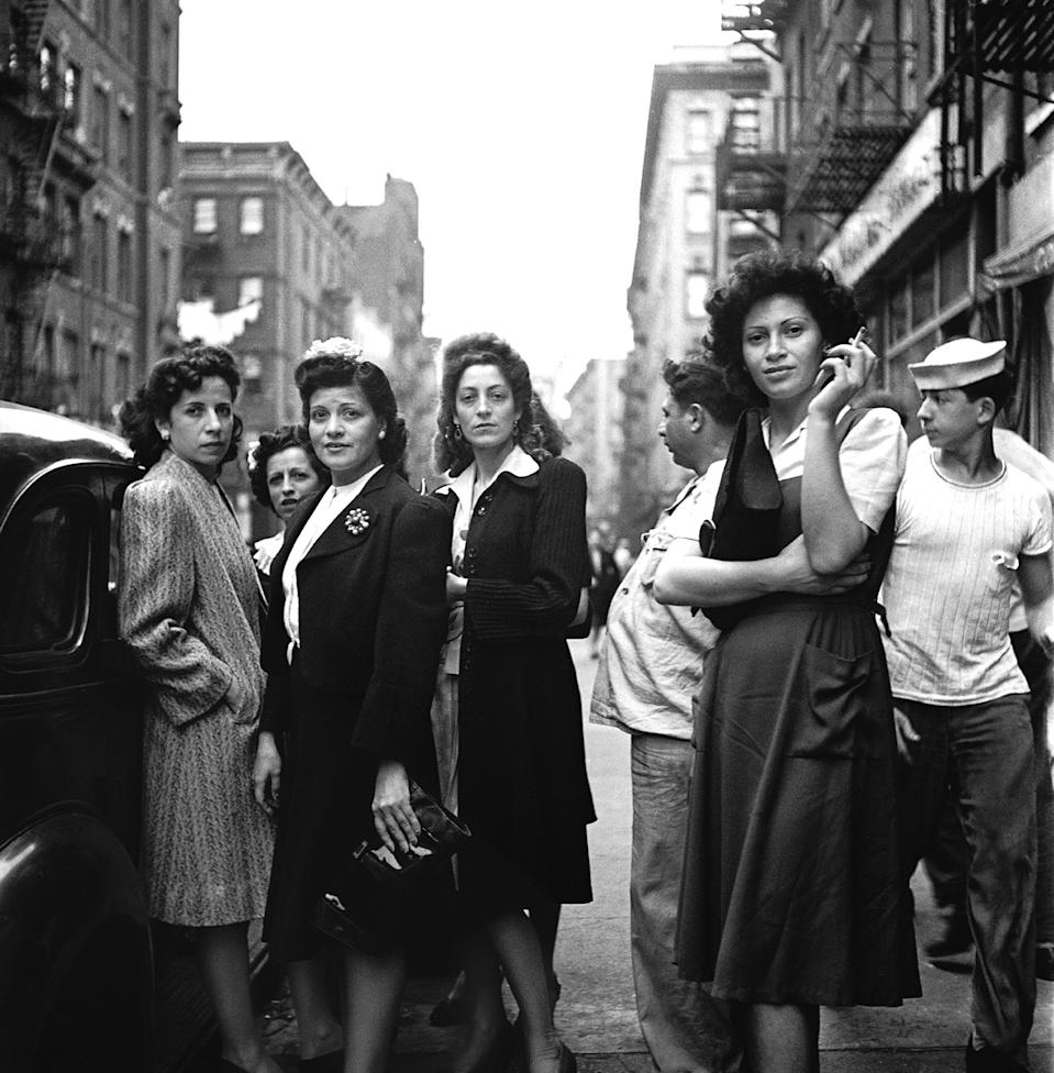 "Portrait of a group of women on a sidewalk in <a href=""https://www.cntraveler.com/gallery/best-italian-restaurants-in-new-york?mbid=synd_yahoo_rss"" rel=""nofollow noopener"" target=""_blank"" data-ylk=""slk:Little Italy"" class=""link rapid-noclick-resp"">Little Italy</a>. The neighborhood, which once encompassed 50 blocks of Lower Manhattan, welcomed hundreds of thousands of Italian immigrants during the late 19th- and early-20th centuries."
