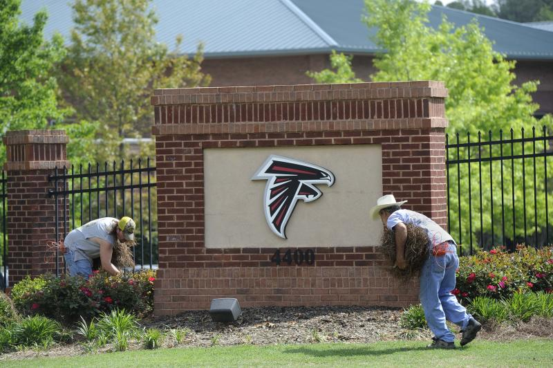 Ken Sanders, right, and Tom Case spruce up the landscaping at the Atlanta Falcons training facility which remains void of player activity, Tuesday, April 26, 2011, in Flowery Branch, Ga. A federal judge ruled in favor of NFL players on Monday, lifting the owners lockout which was imposed after talks between players and owners broke down last month and players disbanded their union. (AP Photo/John Amis)