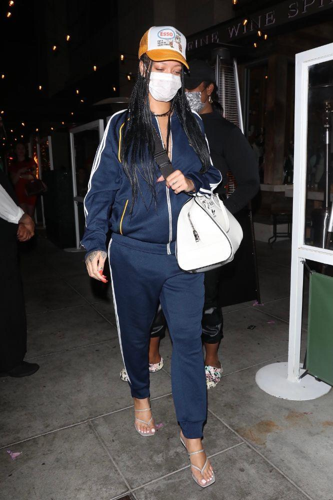 Rihanna steps out in a retro-chic tracksuit for a dinner in Los Angeles on April 12.  - Credit: 007 / photographer group / MEGA