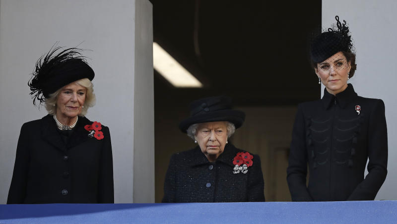 Britain's Queen Elizabeth II, Kate, Duchess of Cambridge, right, and Camilla, Duchess of Cornwall, attend the Remembrance Sunday ceremony at the Cenotaph in Whitehall in London, Sunday, Nov. 10, 2019. Remembrance Sunday is held each year to commemorate the service men and women who fought in past military conflicts. (AP Photo/Matt Dunham)