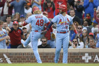 St. Louis Cardinals' Harrison Bader (48) celebrates with teammate Paul DeJong (11) after hitting a solo home run during the second inning of a baseball game against the Chicago Cubs Saturday, Sept. 25, 2021, in Chicago. (AP Photo/Paul Beaty)