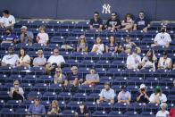 Fans watch during the fourth inning of a spring baseball game between the New York Yankees and the Toronto Blue Jays at George M. Steinbrenner Field, Sunday, Feb. 28, 2021, in Tampa, Fla. (AP Photo/Frank Franklin II)