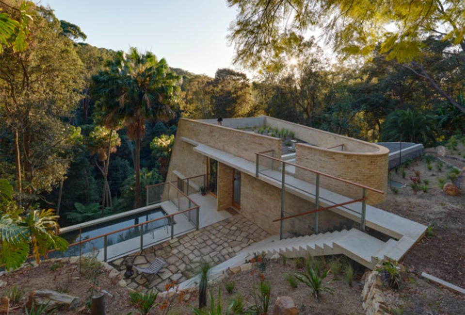Designed by Peter Stutchbury Architecture, the 2018 Australia House of the Year features a luxurious in ground pool with bush land views