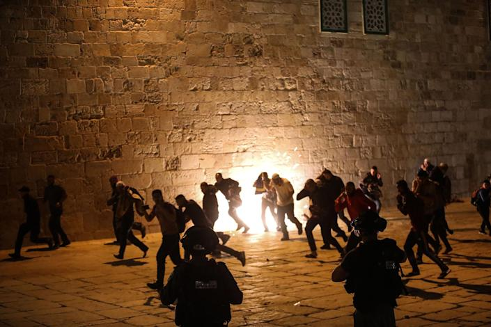 Israeli police use stun grenades and plastic bullets on Muslim worshippers in Haram al-Sharif at the site of the Al-Aqsa Mosque in East Jerusalem on May 7, 2021.