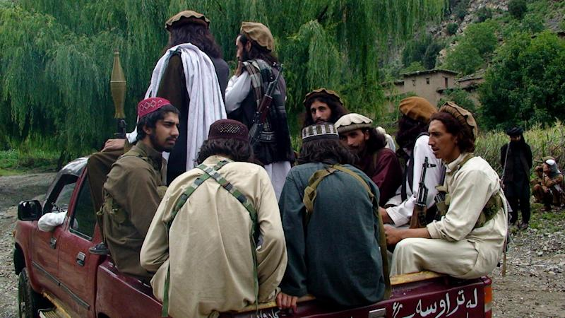 """In this photo taken on Aug. 5, 2012 Pakistani Taliban patrol in their stronghold of Shawal in Pakistani tribal region of South Waziristan. Taliban spokesman Ahsanullah Ahsan told the Associated Press that Taliban threatened to kill a Pakistani cricket star Imran Khan who has become a major political player if he holds a planned march to their tribal stronghold along the Afghan border to protest U.S. drone attacks. Ahsan said """"If he comes, our suicide bombers will target him,"""" (AP Photo/ Ishtiaq Mahsud)"""