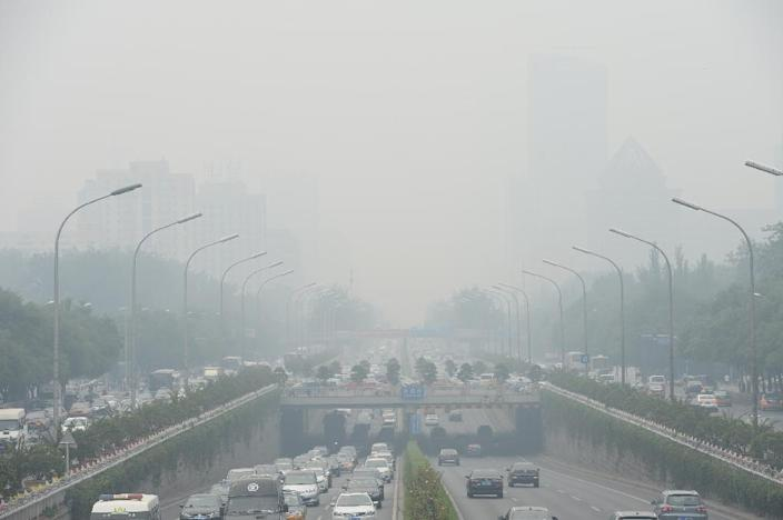 Chinese cities, such as Beijing, pictured in June, are often hit by heavy pollution, blamed on coal-burning by power stations and industry, as well as vehicle use and climatic factors This picture taken on June 23, 2015 shows vehicles running in smog covered streets in Beijing. China's cities are often hit by heavy pollution, blamed on coal-burning by power stations and industry, as well as vehicle use. The issue has become a major source of popular discontent with the Communist Party, leading the government to vow to reduce the proportion of energy derived from fossil fuels. CHINA OUT AFP PHOTO (AFP Photo/STR)
