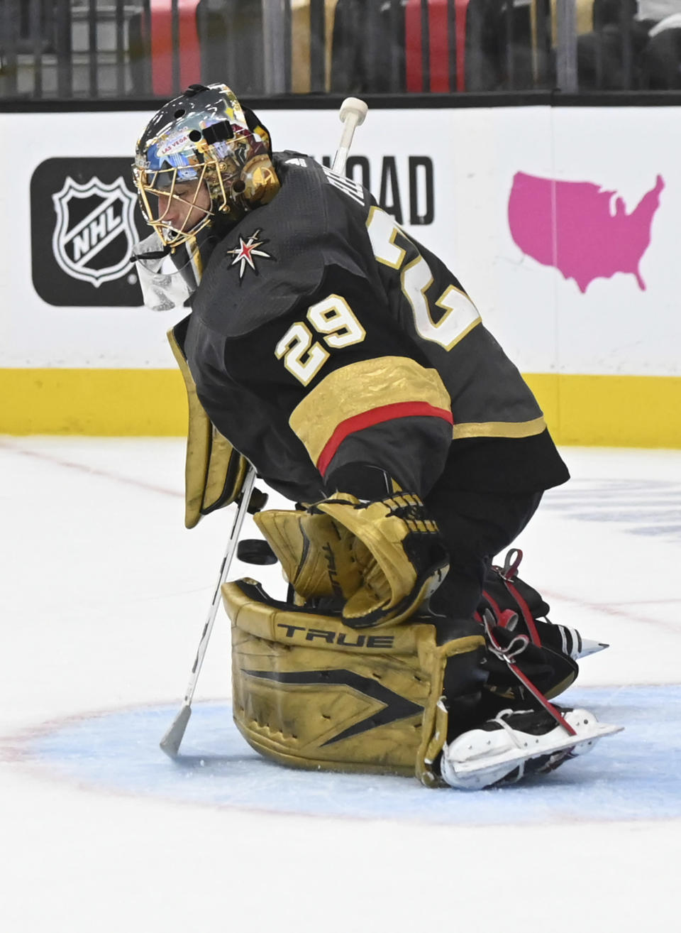 Vegas Golden Knights goaltender Marc-Andre Fleury (29) stops the puck during the third period of Game 1 of a first-round NHL hockey playoff series against the Minnesota Wild, Sunday, May 16, 2021, in Las Vegas. (AP Photo/David Becker)