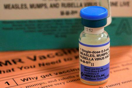 FILE PHOTO: A vial of measles, mumps and rubella vaccine and an information sheet is seen at Boston Children's Hospital in Boston, Massachusetts February 26, 2015.   REUTERS/Brian Snyder/File Photo