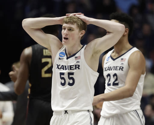 Xavier guard J.P. Macura (55) reacts to a call, during the second half of a second-round game against Florida State, in the NCAA college basketball tournament in Nashville, Tenn., Sunday, March 18, 2018. (AP Photo/Mark Humphrey)