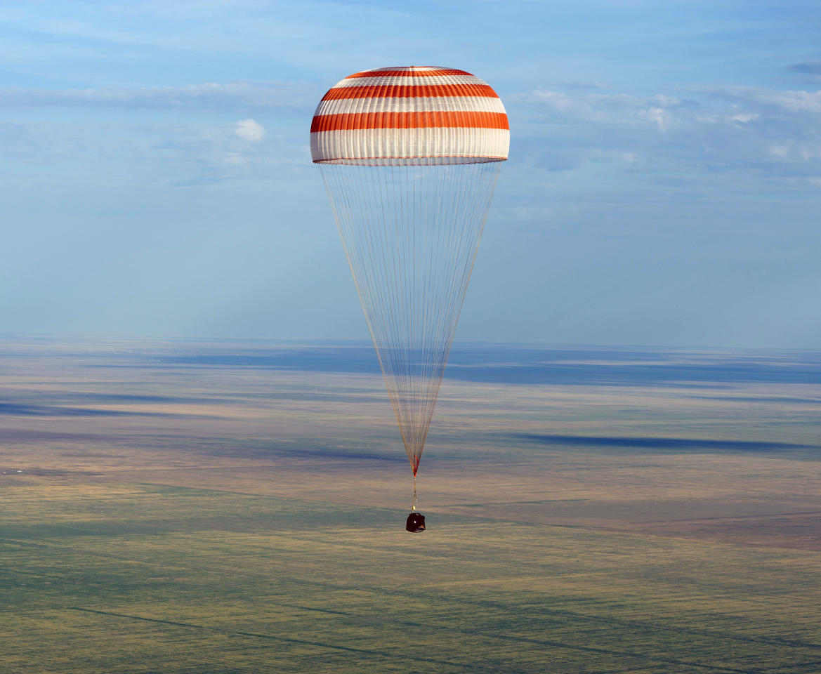 In this photo provided by NASA, the Soyuz TMA-04M spacecraft lands with Expedition 32 Commander Gennady Padalka of Russia, NASA Flight Engineer Joe Acaba and Russian Flight Engineer Sergie Revin in a remote area near the town of Arkalyk, Kazakhstan, on Monday, Sept. 17, 2012. Padalka, Acaba and Revin returned from five months onboard the International Space Station where they served as members of the Expedition 31 and 32 crews. (AP Photo/NASA, Carla Cioffi)