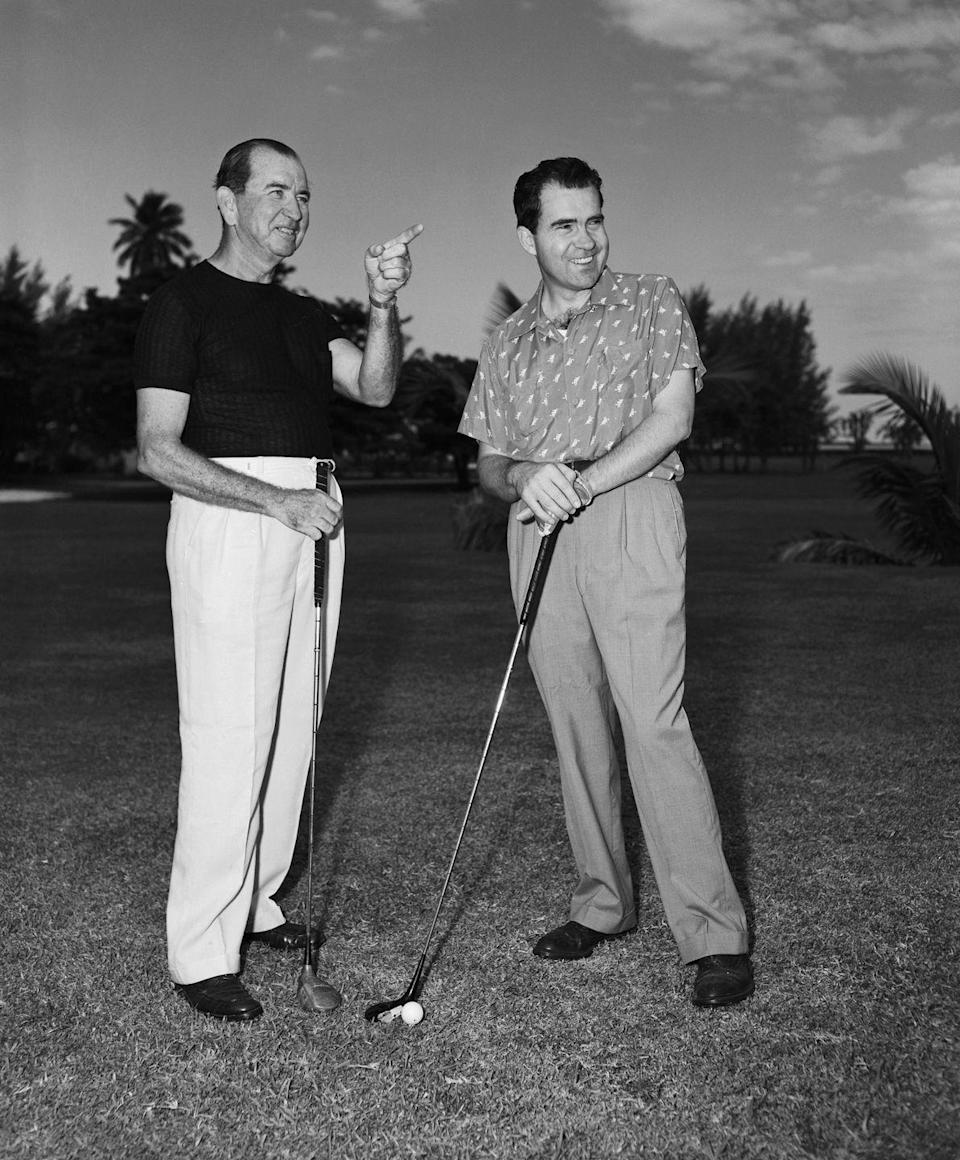 <p>Richard Nixon, vice president at the time, gets golfing guidance during a vacation. </p>