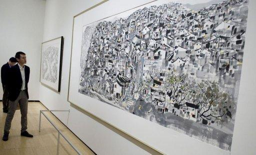 Wu Tim, grandson of Chinese artist Wu Guanzhong, views the exhibit of works by his grandfather