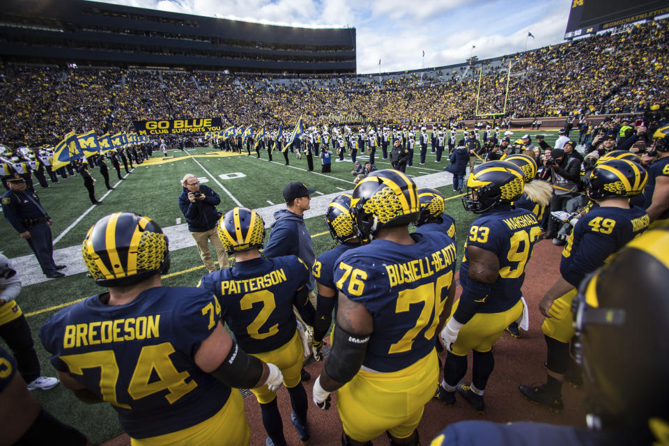 Michigan coach Jim Harbaugh has the Wolverines in contention for the College Football Playoff. (AP)