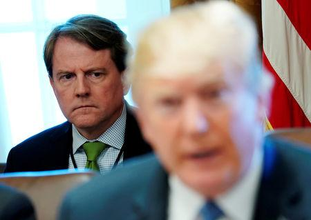 White House Counsel Don McGahn sits behind U.S. President Donald Trump as the president holds a cabinet meeting at the White House in Washington, U.S. June 21, 2018.  REUTERS/Jonathan Ernst/Files