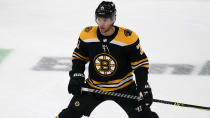 Boston Bruins left wing Taylor Hall, who was acquired in a trade with the Buffalo Sabres, stretches during warmups for the team's NHL hockey game against his former team, Tuesday, April 13, 2021, in Boston. (AP Photo/Charles Krupa)