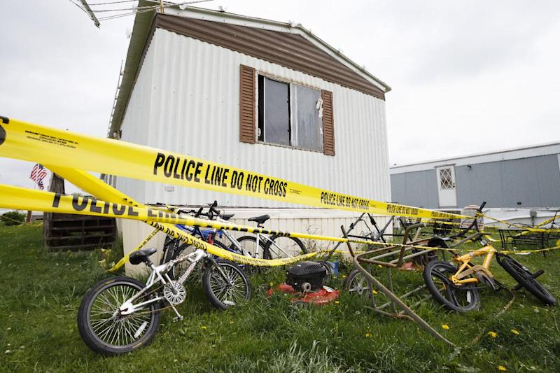 Bicycles sit behind the home of Blake and Blaine Romes in Ottawa, Ohio, Friday, May 10, 2013. Two teenage brothers who had been reported missing were found dead after a third teen pointed authorities to their bodies before he was taken into custody, officials said. The three teens, 14-year-old Blaine Romes, 17-year-old Blake Romes and 17-year-old Michael Fay, lived together with their mothers inside a trailer home in Ottawa in northwest Ohio, neighbors said. The three had been the subject of an Amber Alert issued Thursday morning after a relative returned to the home and found a crime scene, the Putnam County Sheriff's Office said. Fay was taken into custody Thursday afternoon. (AP Photo/Rick Osentoski)