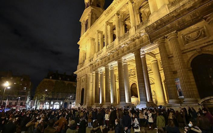 Catholics gathered outside Saint Sulpice Church to protest by singing and praying against the closure of Sunday Mass - Julien Mattia/Anadolu Agency via Getty Images