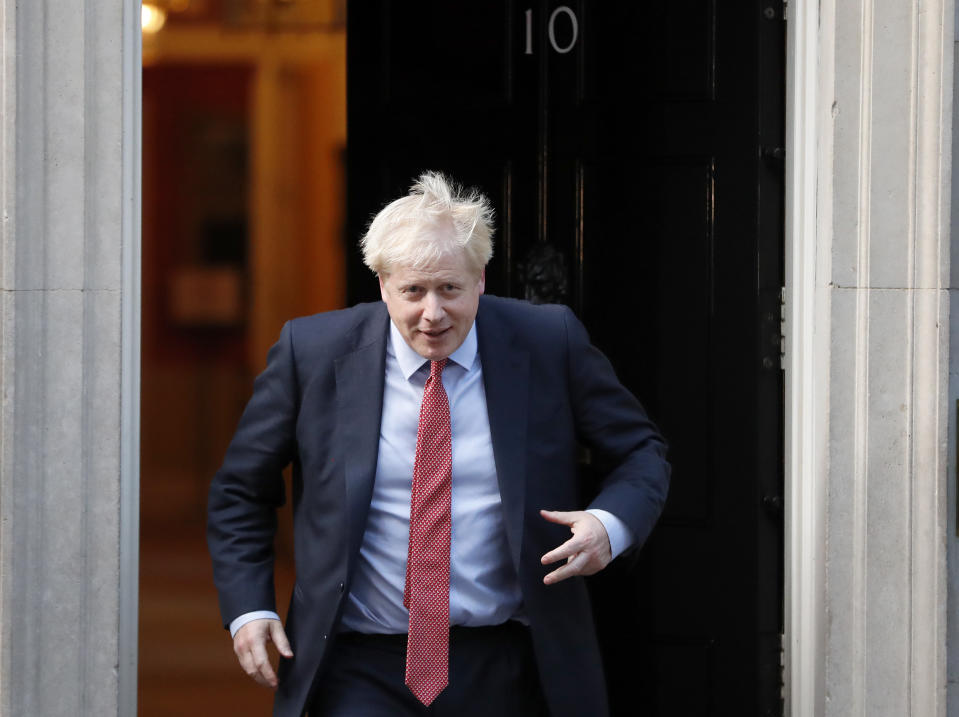 Britain's Prime Minister Boris Johnson leaves 10 Downing Street to welcome the President of the European Parliament David Sassol in London, Tuesday, Oct. 8, 2019.(AP Photo/Frank Augstein)