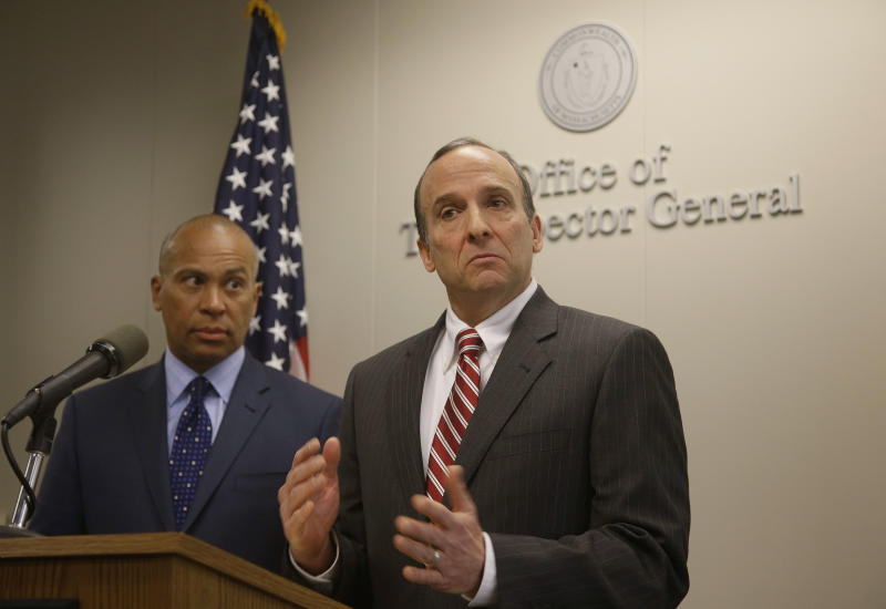 Massachusetts Inspector General Glenn A. Cunha releases the findings of his investigation of the Hinton Drug Lab at the offices of the Inspector General as Massachusetts Gov. Deval Patrick, left, looks on during a media availability in Boston, Tuesday, March 4, 2014. The Hinton Drug Lab was shut down in 2012 in the wake of criminal acts by forensic chemist Annie Dookhan. (AP Photo/Stephan Savoia)