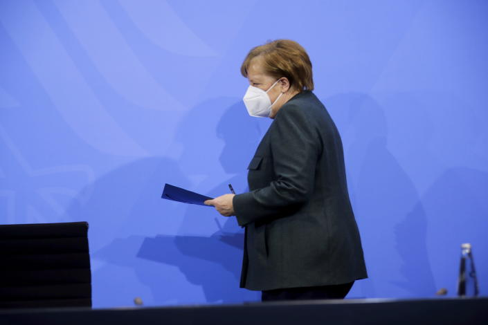 German Chancellor Angela Merkel arrives for a news conference on further coronavirus measures, at the Chancellery in Berlin, Germany, Tuesday Jan. 19, 2021. (Hannibal Hanschke/Pool via AP)