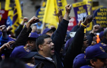 Members of the Service Employees International Union (SEIU) chant slogans during a protest in support of a new contract for apartment building workers in New York City, April 2, 2014. REUTERS/Mike Segar