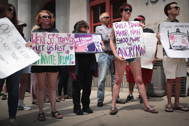 Demonstrators outside of the Dayton City Hall protest a planned visit of President Donald Trump on August 06, 2019 in Dayton, Ohio. Trump was scheduled to visit the city on Wednesday as residents recover from Sunday Morning's mass shooting in the Oregon District.