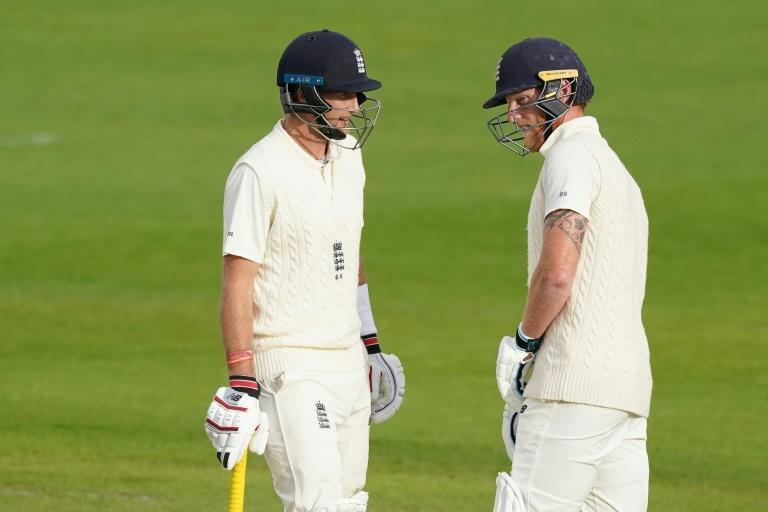 England's Joe Root (L) chats with Ben Stokes (R)