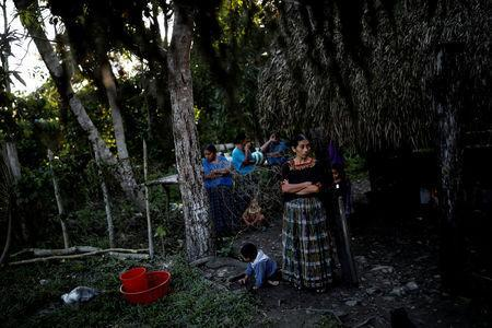 A woman waits for the arrival of a coffin with the remains of Jakelin Caal, a 7-year-old girl who died after being detained by U.S. border agents, at Jakelin's grandmother's home in San Antonio Secortez, Guatemala December 22, 2018.Picture taken December 22, 2018. REUTERS/Carlos Barria