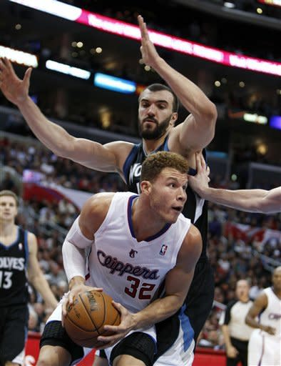 Los Angeles Clippers' Blake Griffin is pressured by Minnesota Timberwolves' Nikola Pekovic during the first half of an NBA basketball game in Los Angeles, Wednesday, Nov. 28, 2012. (AP Photo/Christine Cotter)