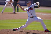 Atlanta Braves relief pitcher Mark Melancon (36) works in the eighth inning during Game 1 of a National League wild-card baseball series between the Atlanta Braves and the Cincinnati Reds, Wednesday, Sept. 30, 2020, in Atlanta. (AP Photo/John Bazemore)