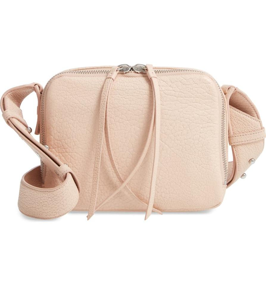 "<p>Transport this ultra-chic yet practical crossbody bag with you wherever you go. Made from grained leather in three different shades, this takes your everyday compact bag to a whole new level.</p> <p><strong>To buy:</strong> $186; <a href=""https://click.linksynergy.com/deeplink?id=93xLBvPhAeE&mid=1237&murl=https%3A%2F%2Fshop.nordstrom.com%2Fs%2Fallsaints-vincent-leather-crossbody-bag%2F5264380&u1=RS%2C6DesignerHandbagsWe%25E2%2580%2599reObsessedWithFromtheNordstromAnniversarySale%2Ctkraus1271%2CSHO%2CIMA%2C622372%2C201907%2CI"" target=""_blank"">nordstrom.com</a>.</p>"
