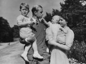 FILE - In this Aug. 1951 file photo, Britain's Queen Elizabeth II, then Princess Elizabeth, stands with her husband Prince Philip, the Duke of Edinburgh, and their children Prince Charles and Princess Anne at Clarence House, the royal couple's London residence. Prince Philip was born into the Greek royal family but spent almost all of his life as a pillar of the British one. His path was forged when he married the heir to the British throne, and a promising naval career was cut short when his wife suddenly became Queen Elizabeth II. Nevertheless, he set about forging a place for himself as royal consort. He was a patron of charities and a supporter of projects for young people. He was married for more than 73 years and was still carrying out royal engagements into his late 90s. (AP Photo/Eddie Worth, File)
