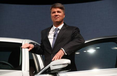 Krueger, BMW CEO with a BMW 530e iPerformance before the company's annual news conference in Munich