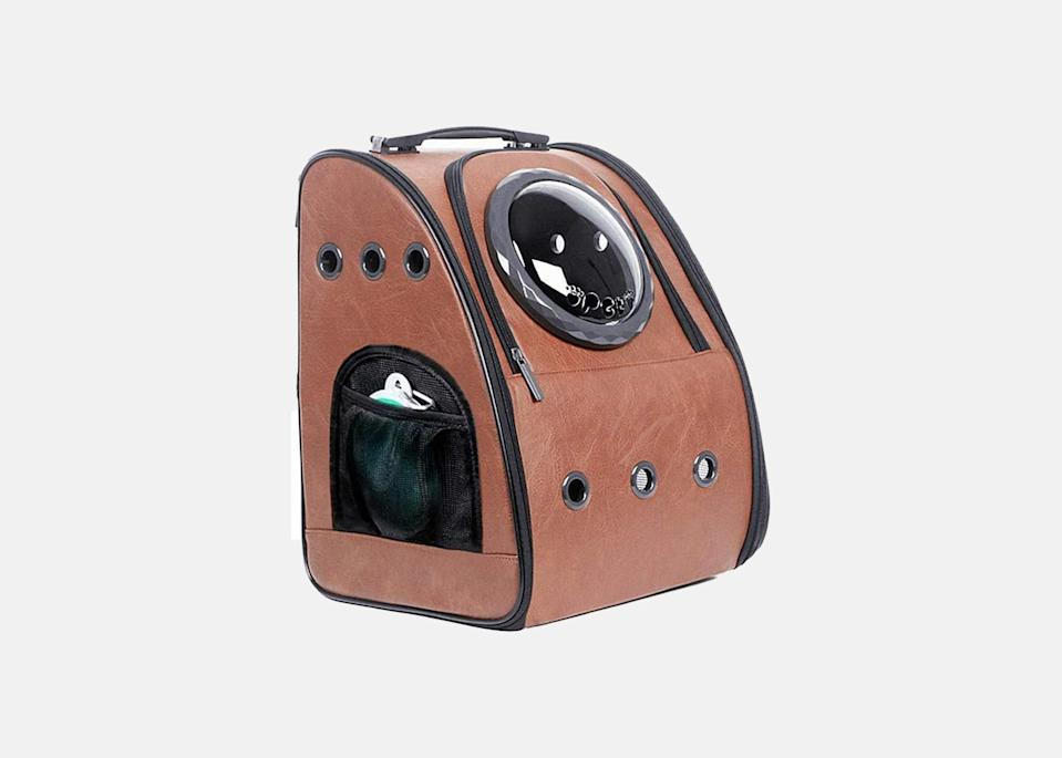 """<p>Similar to the iconic cat backpack Taylor Swift made popular in <em>Miss Americana</em>, this carrier provides a hands-free option for travelers with small pets. It's designed with a soft, removable mat, nine holes for ventilation, and a transparent bubble dome so your pet can people- (or animal-) watch in the airport. The side pouch is perfect for storing essentials like a water bottle or extra food, and the ease of a backpack will make gathering all of your belongings in the airport smoother.</p> <p><strong>Buy now:</strong> <a href=""""https://amzn.to/39eNiqs"""" rel=""""nofollow noopener"""" target=""""_blank"""" data-ylk=""""slk:$57, amazon.com"""" class=""""link rapid-noclick-resp"""">$57, amazon.com</a></p>"""