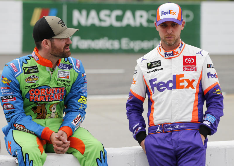 MARTINSVILLE, VIRGINIA - OCTOBER 26: Corey LaJoie, driver of the #32 CorvetteParts.net Ford, talks with Denny Hamlin, driver of the #11 FedEx Freight Toyota, during qualifying for the Monster Energy NASCAR Cup Series First Data 500 at Martinsville Speedway on October 26, 2019 in Martinsville, Virginia. (Photo by Brian Lawdermilk/Getty Images)