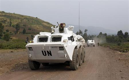 U.N. peacekeepers drive in their APC as they patrol the road towards Kibati