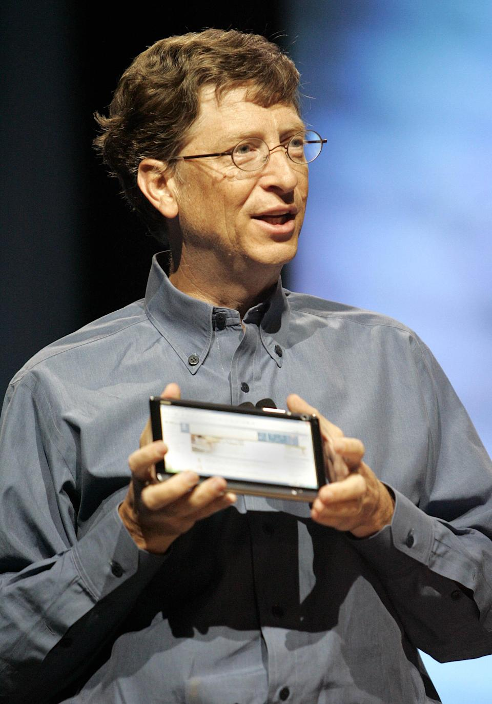"""FILE- In an April 25, 2005, file photo provided by Microsoft, then Microsoft Chairman and Chief Software Architect Bill Gates shares a prototype of an """"ultra-mobile"""" Tablet PC during a keynote speech for attendees at the Microsoft Windows Hardware Engineering Conference in Seattle. For decades, the tablet computer was like a mirage in the technology industry: a great idea, seemingly reachable on the horizon, that disappointed as hopeful companies got closer."""" (AP Photo/Microsoft, Robert Sorbo, File)"""