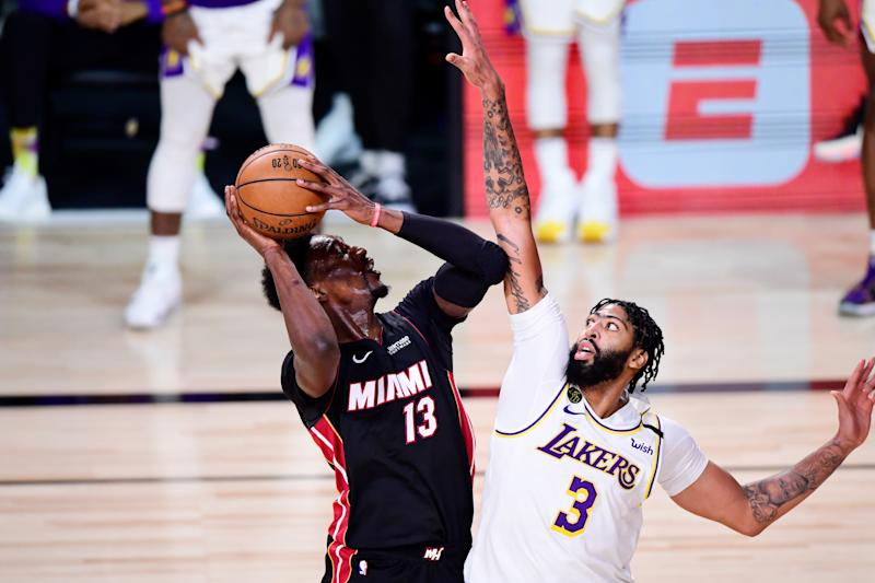 Bam Adebayo #13 of the Miami Heat drives the ball against Anthony Davis #3 of the Los Angeles Lakers during the fourth quarter in Game Six of the 2020 NBA Finals