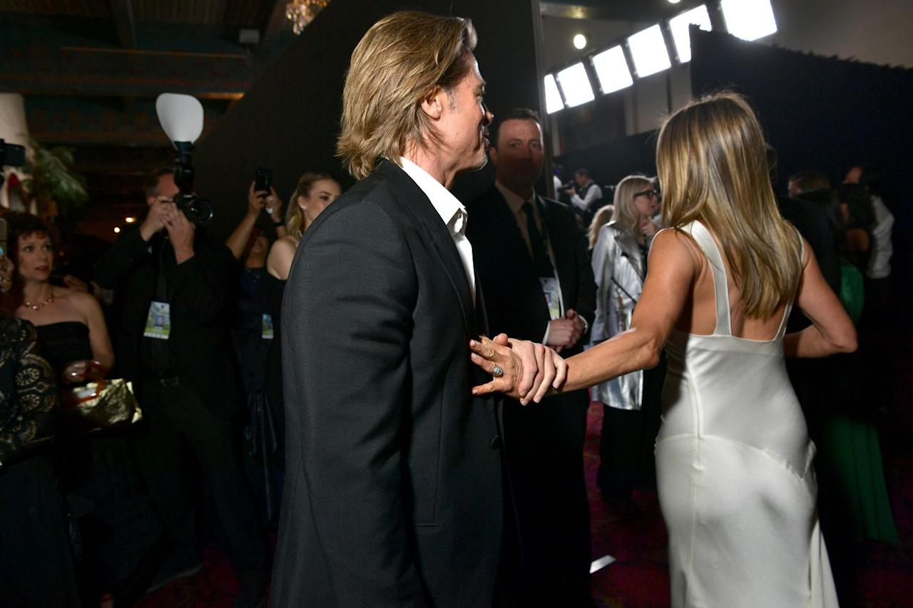 """<p>This is when their body language turns up a notch. """"The area in which Brad is holding [Jennifer's] hand is a personal zone,"""" says Donaldson. """"This tells us there is a certain level of trust and familiar level of comfort and intimacy between the two of them."""" But, """"touch can have various meanings depending on the social settings"""" she adds. Here, Brad is asking for attention, but Jennifer, according to Donaldson, is either over the moment or teasing him.</p>"""