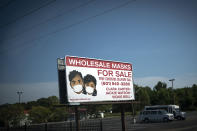 A sign advertises face masks for sale along a major road, Sunday, Oct. 4, 2020, in Jackson, Miss. Across the country, racial minorities, especially Black people, have been hit hard by COVID-19. They are more likely to live in crowded housing and work essential jobs, whether in grocery stores or hospitals, and have a long history of second-rate health care. African Americans have also long struggled with chronic health problems that can cause more deaths from COVID-19. (AP Photo/Wong Maye-E)